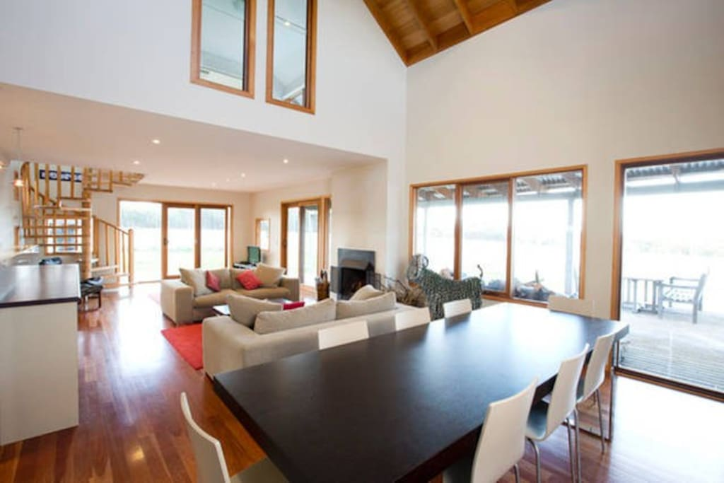 The open plan dining area easily seats 10 while the kitchen bar seats an additional 3.