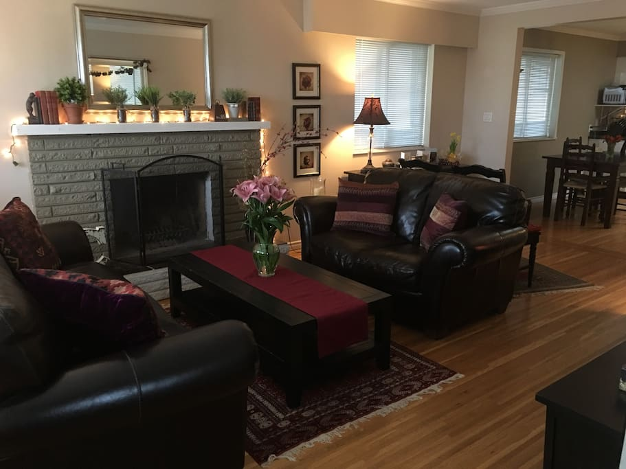 Front living room is airy and bright, leads into dining room and kitchen, very spacious