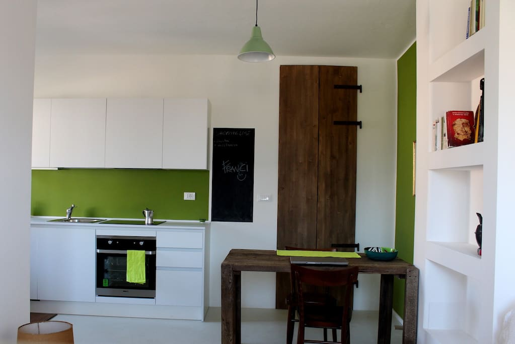 The dining table and open space kitchen