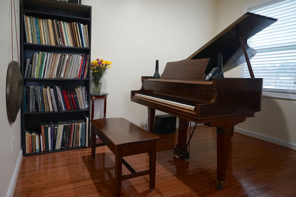 Across from the bed is the piano. Feel free to play and browse our sheet music library!