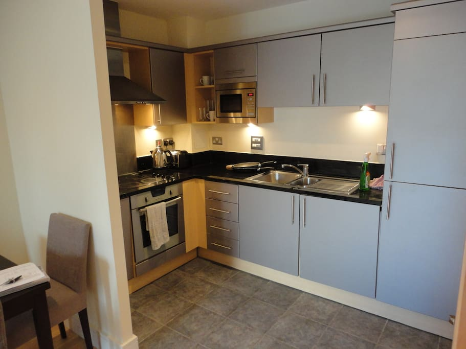 Kitchen off living area, fully equipped with cooker, oven, washing machine/dryer, dish washer