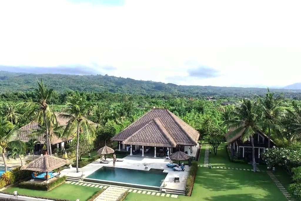 Aerial view of the villa, with to the right the guest house. Behind the beautiful scenery of North Bali!