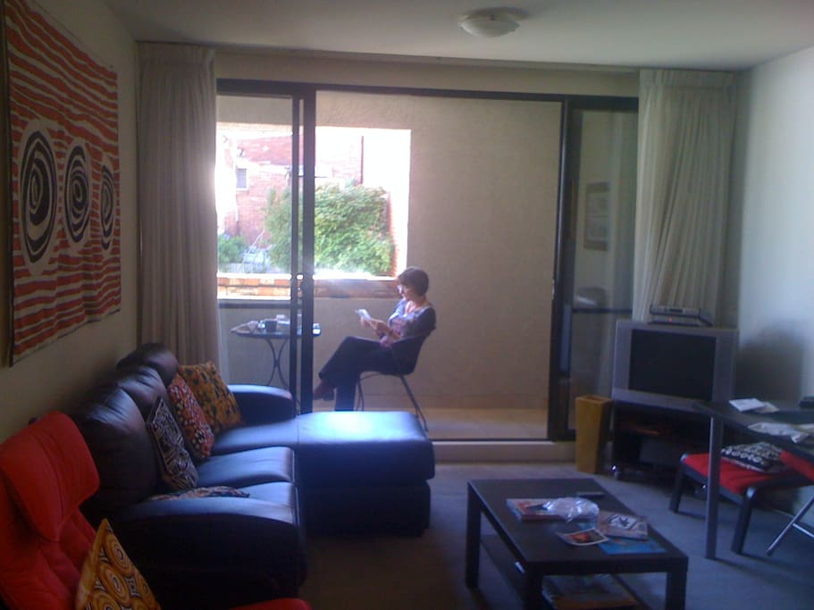 Lounge room with NBN internet TV looking out to balcony-overlooking Pinkys Lane, but one level up.