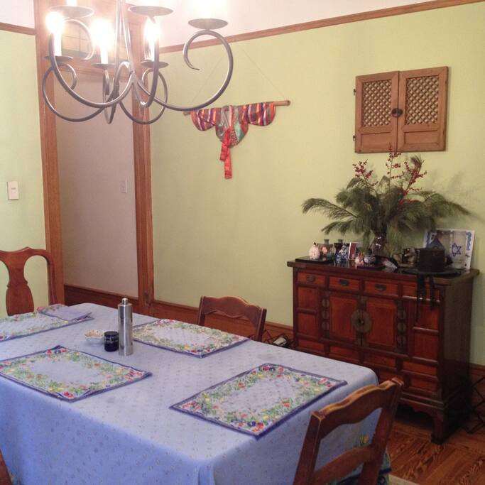 Our dining room.  Great table for family dinners.  Also has an in-tune piano for any musicians out there.