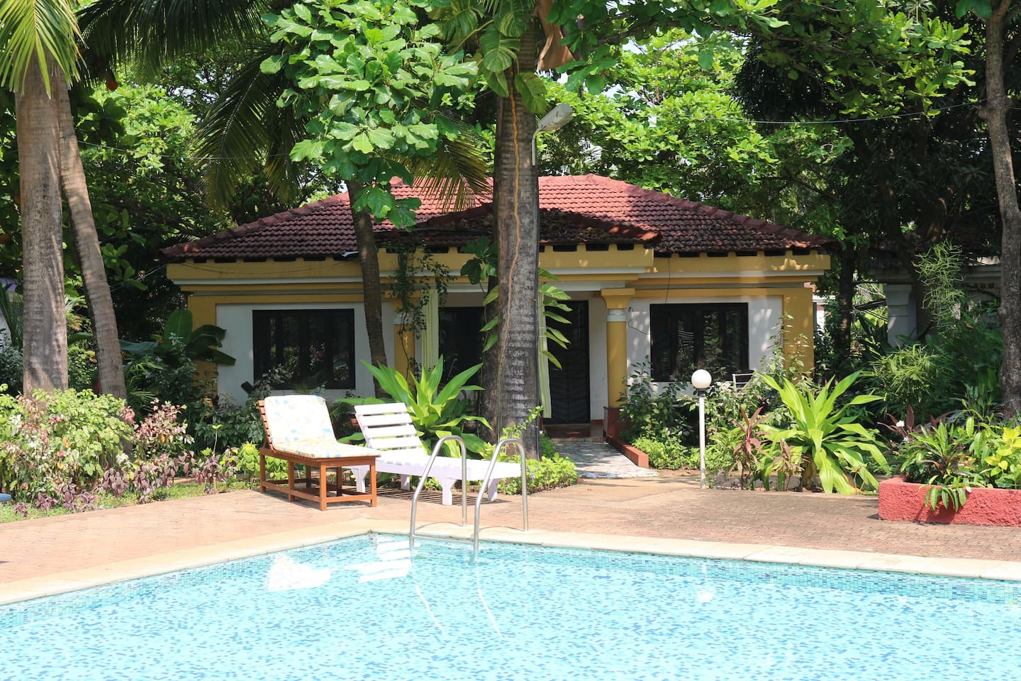 Front of Villa Shanti opens to a swimming pool