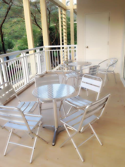 Balcony with 2 round table and 9 seats