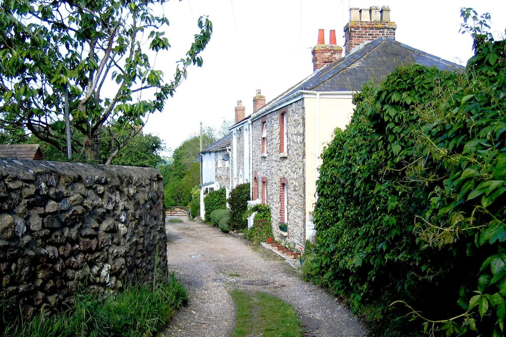 Lane with cottage on right