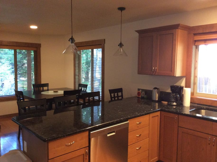 Fully stocked modern kitchen with dining area for the whole family!