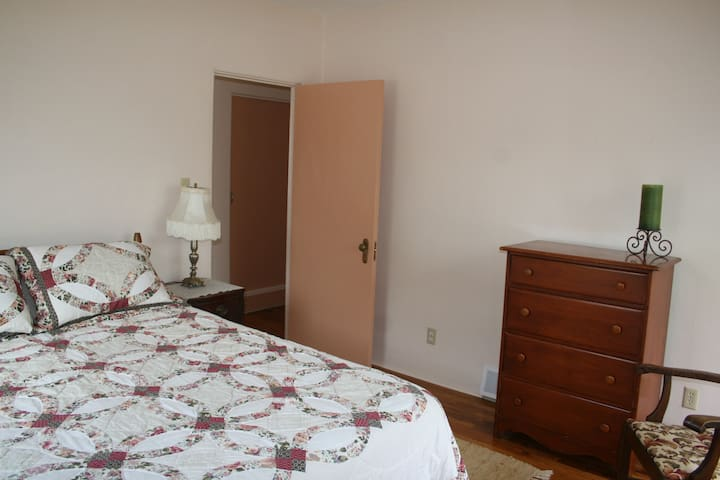 Queen bed in bedroom 2.  There is also a dresser and a large closet.