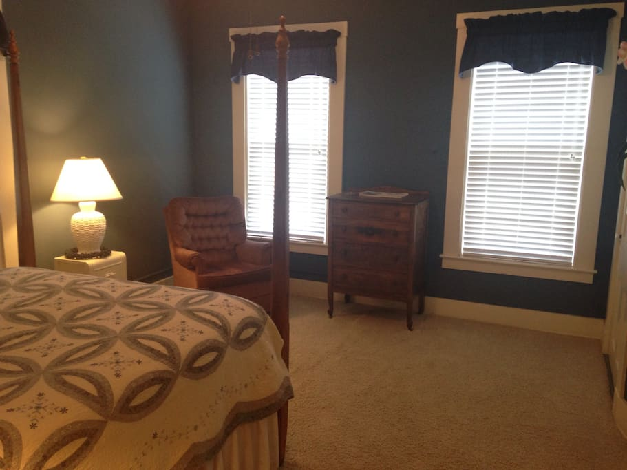 Large, spacious room with seating, a dresser, and closet space.