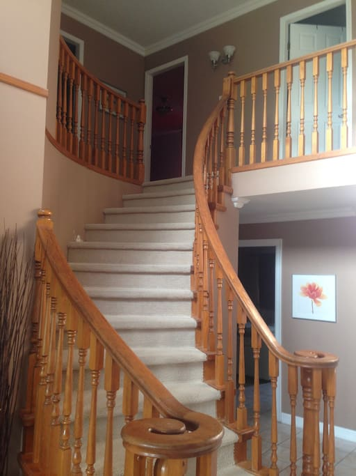 Entrance staircase leading up to cozy room 3 on the right