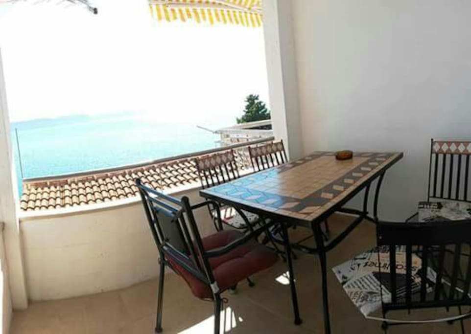 Terrace with dining area and beautiful sea view