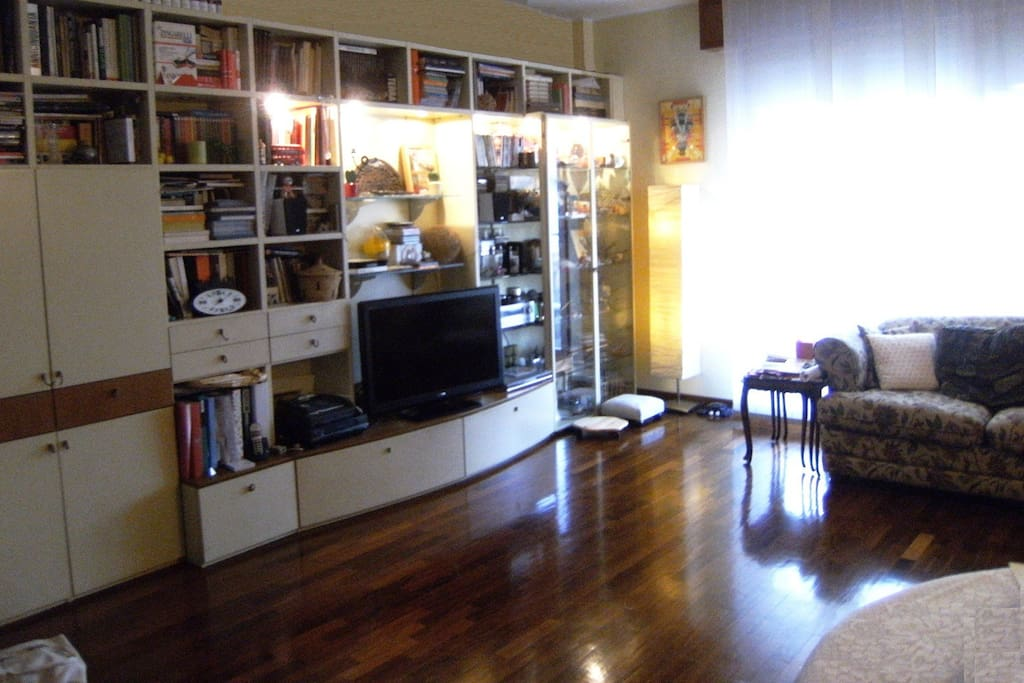 The living room is quite spacious. The big windows opens on  the  balcony (small terrace).