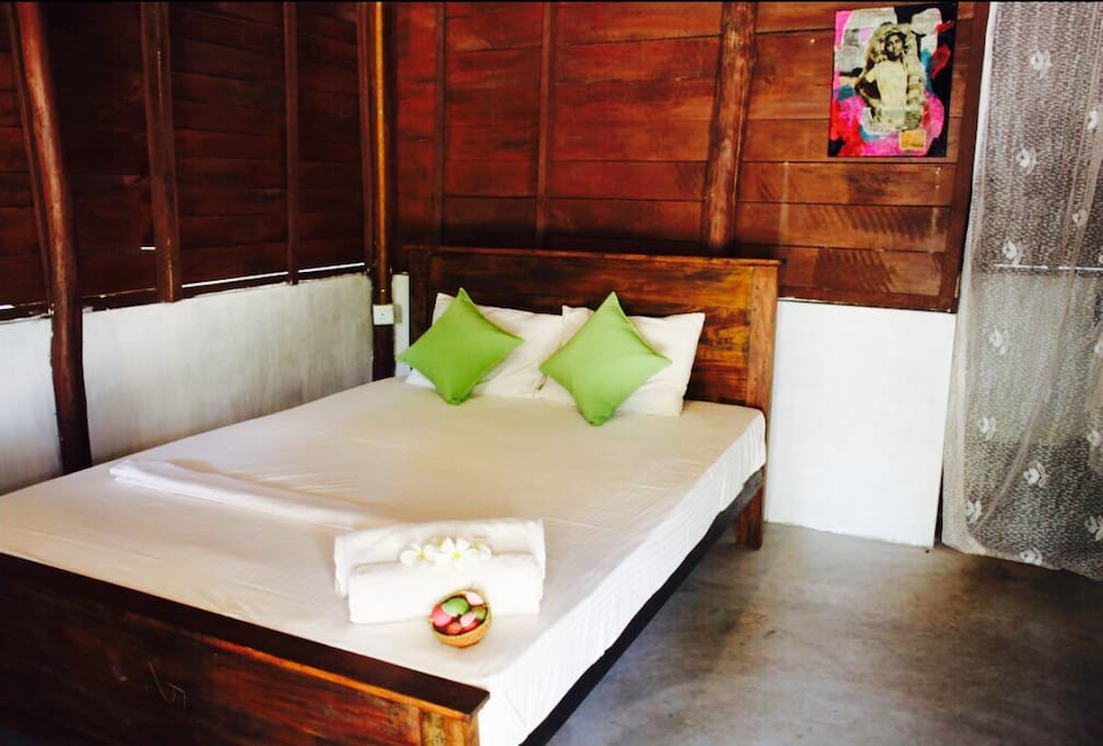 Our cabanas are individually designed rustic, traditional and with pops of colour! Check out our unique artworks.  This is cabana 1.