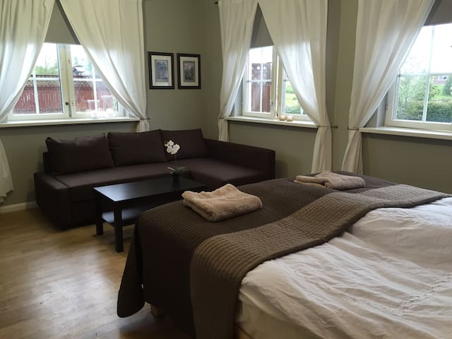 Room #5 is a 20 sqf bedroom with 1.8x2 m double bed and a sleeping sofa.