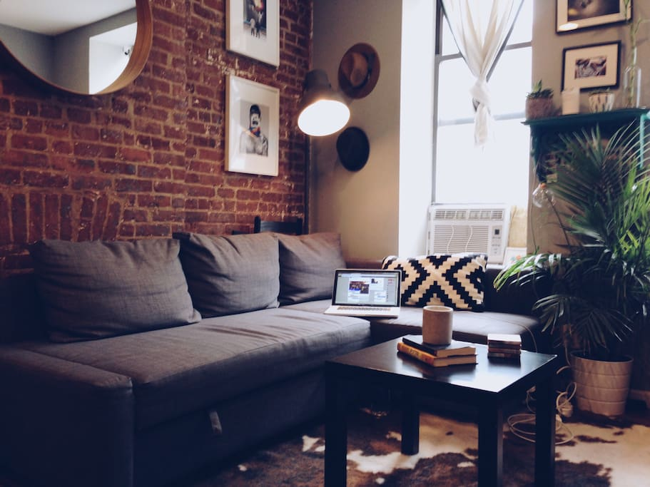 Take selfies in front of the exposed brick and pull out the couch for another queen sized bed when you and your guests are ready to rest.