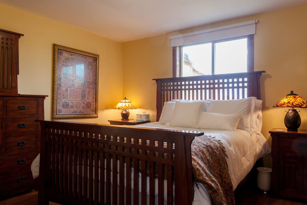 Master bedroom has gorgeous solid mahogany queen bed, organic mattress, luxury 520-threadcount cotton bedding.  View out the window is garden and vineyard.