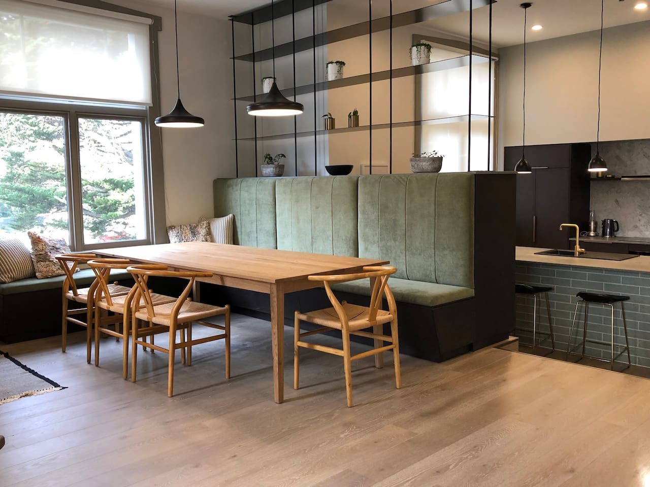 A large oak dining or meeting table comfortably seats 12. Numerous eateries and catering options are available nearby. Jizo and Shinjuku Japanese cafés across the road are favourites among Dunedin locals. Countdown supermarket is in walking distance.