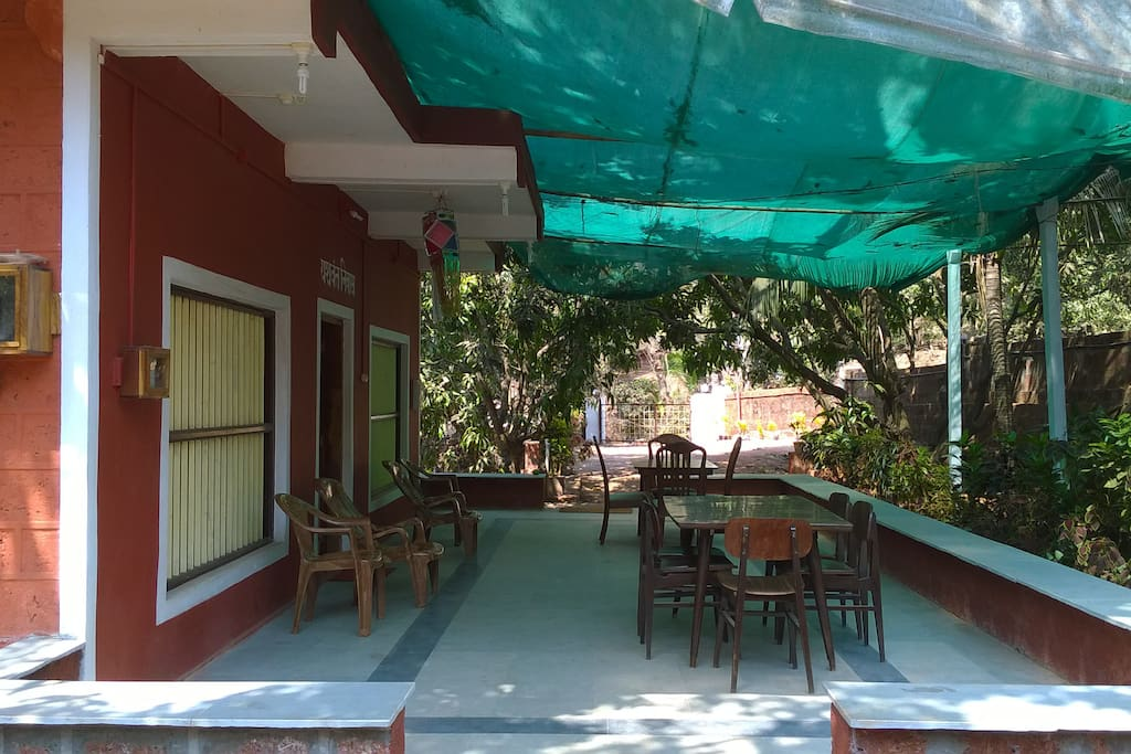 SEATING AND DINING AREA IN FRONT OF THE VILLA