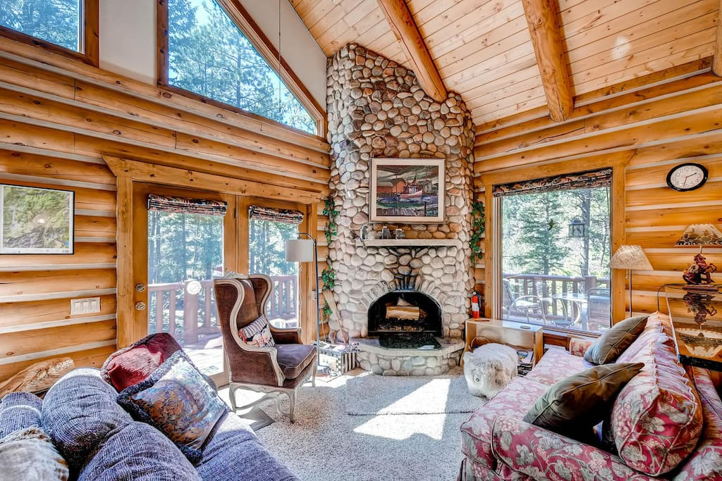The livingroom and the floor to ceiling river rock fireplace