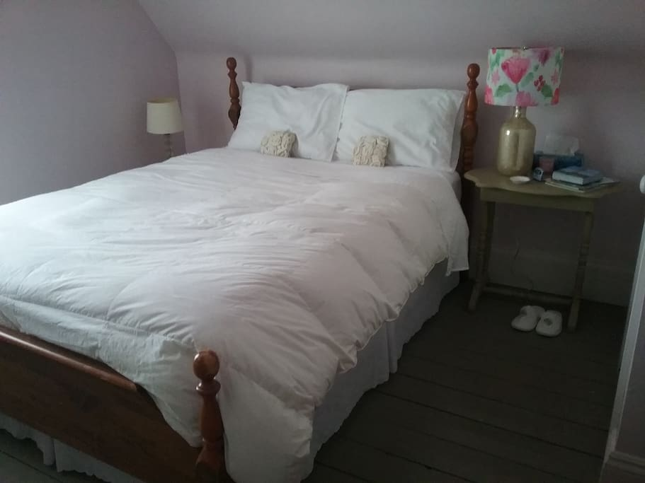 Queen size bed with cotton sheets and a down filled duvet