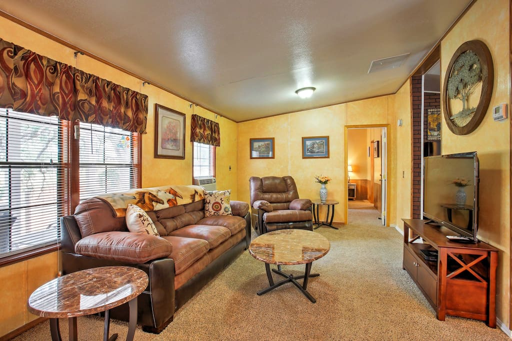 Kick back and relax on the plush leather sofa or matching recliner in the living room and enjoy the flat-screen satellite TV.