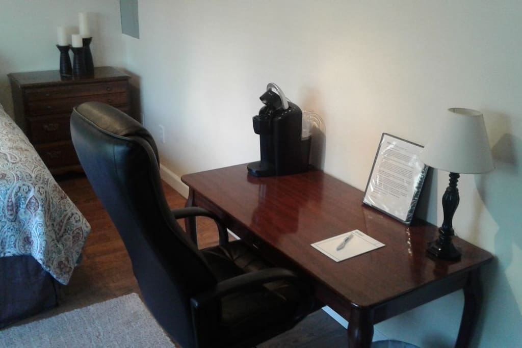 Desk, Keurig coffee maker and rolling office chair