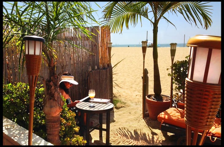 Enjoy dining or sun lounging on our private tropical sand patio