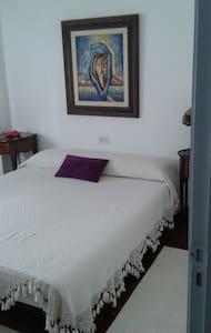Habitación con cama de matrimonio - Tui