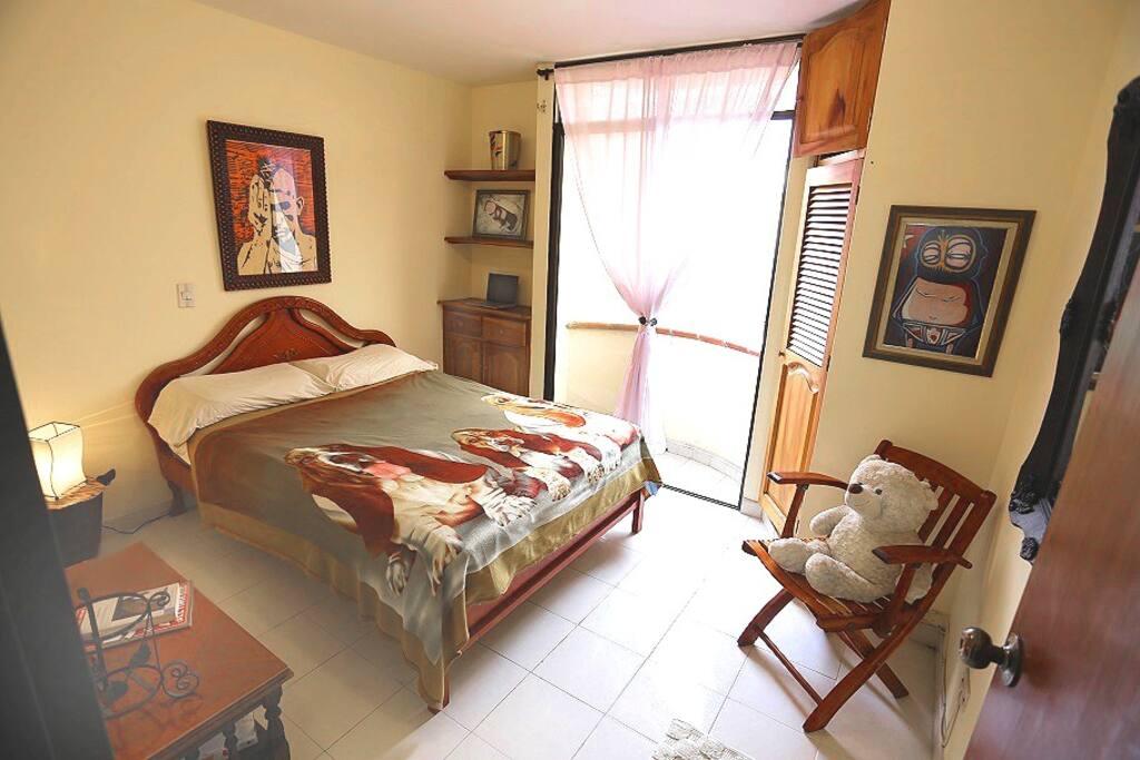 Queen-sized bedroom and balcony