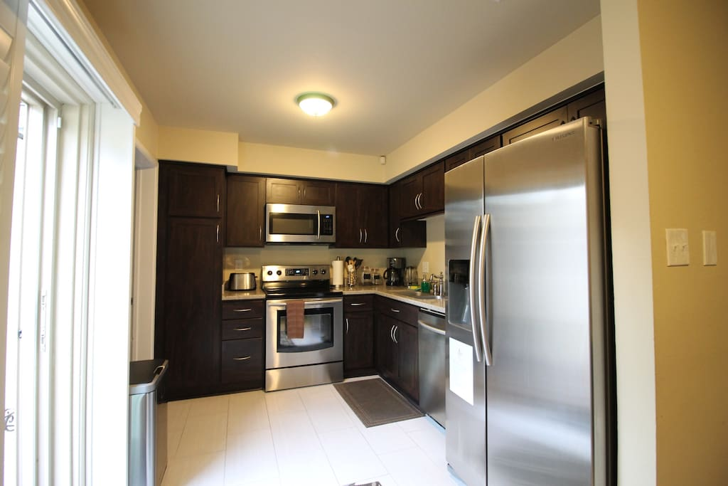 Fully-stocked kitchen with all the amenities, appliances, and utensils you need.