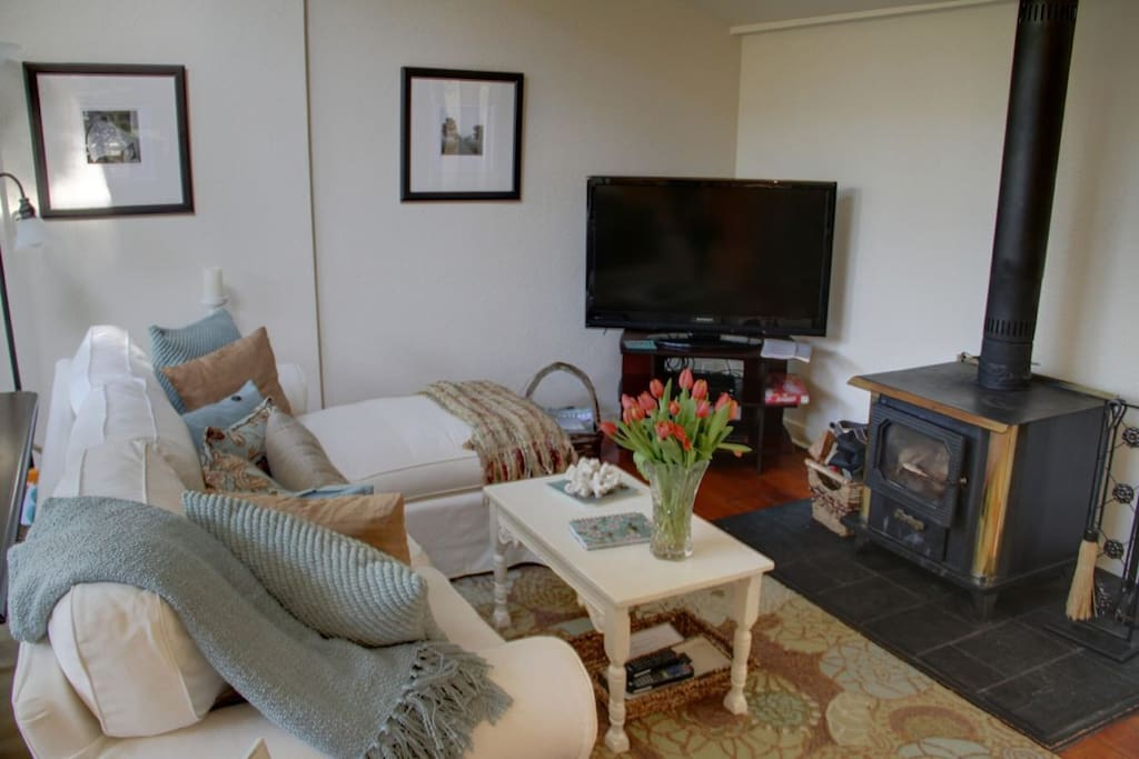 """Wood buring stove and 46"""" flat screen HDTV are perfect for a cozy night inside."""