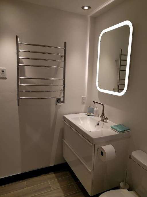 Heated Flooring and Towel Rail in Bathroom. The Sink Drawers have plenty of Storage.