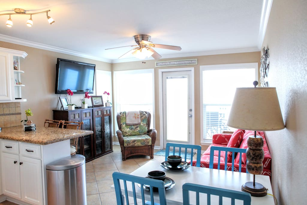 The living space is bright, airy, comfortable, and has many seating options.