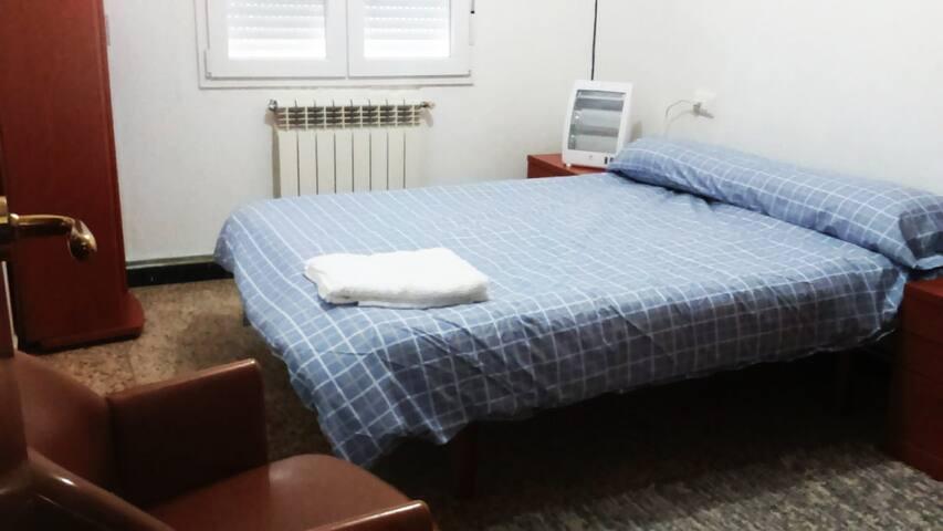 Habitación luminosa para tu descanso