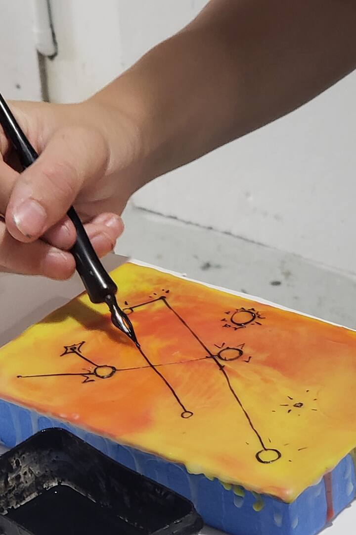 Drawing on cooled wax with a dip pen
