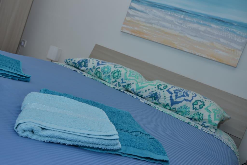 Bathroom towels and full bed linen including duvet