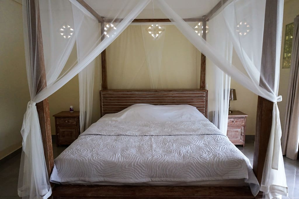 Comfy four poster  king size bed with mosquito nets