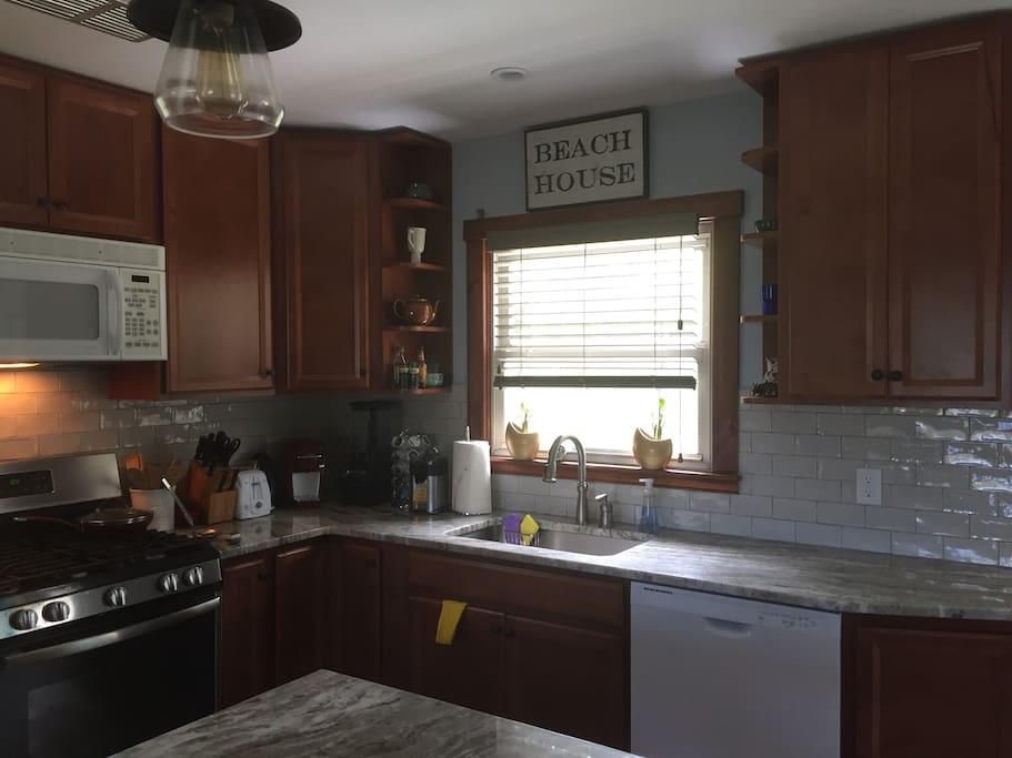 Kitchen, stone counters, tiled backsplash, countertop appliances
