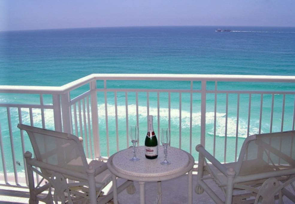 Sip champagne, watch the dolphins from master bedroom balcony.