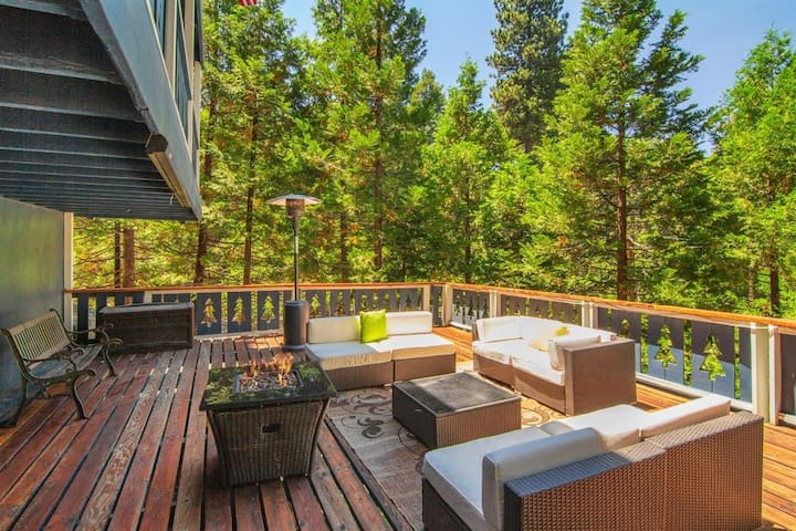 Our deck offers plenty of privacy in the mountains with access to our firepit and heat lamp