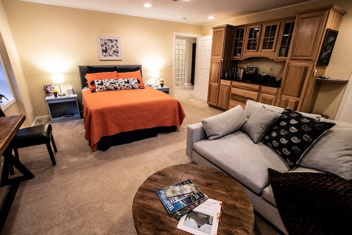 Plush queen size bed with sitting area
