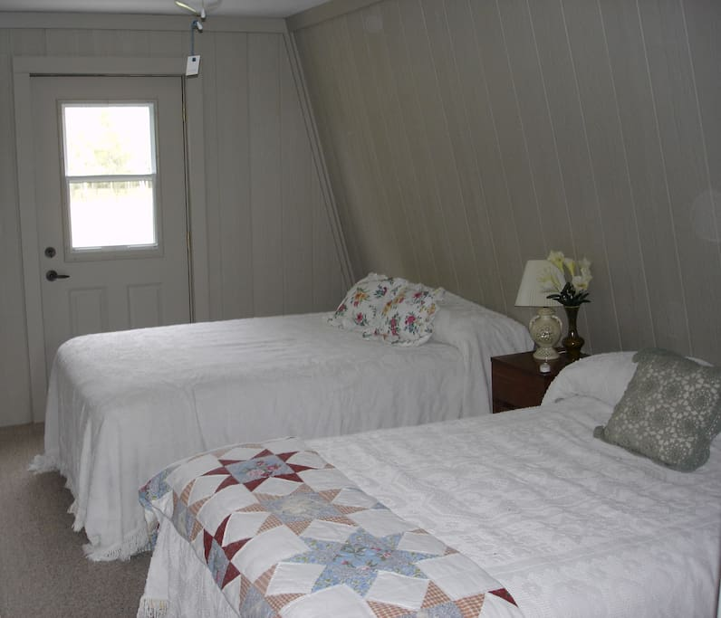 North bedroom.  Two double beds
