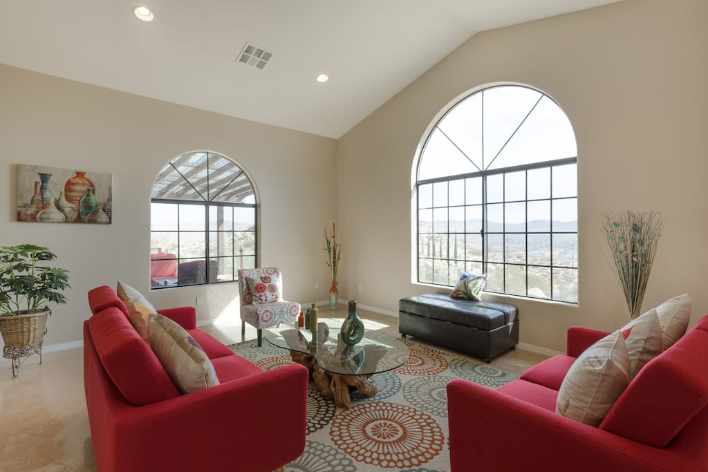 Living room with a huge window and city view