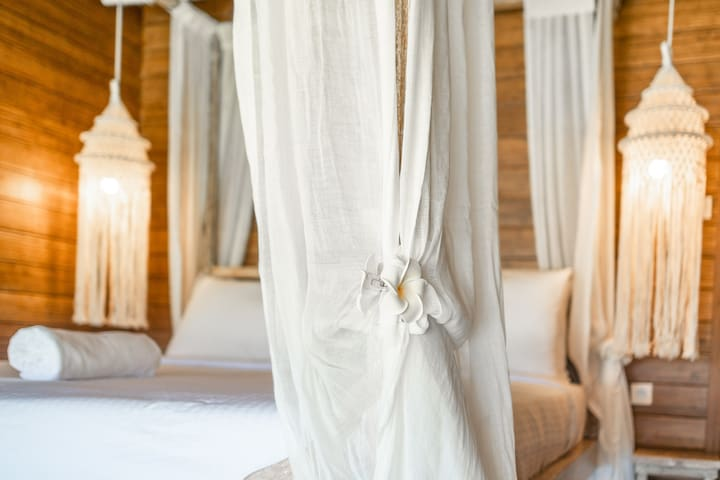 Your bedroom equipped with a comfy double bed, 2 AC, private bathroom, safety box, and rice paddies view