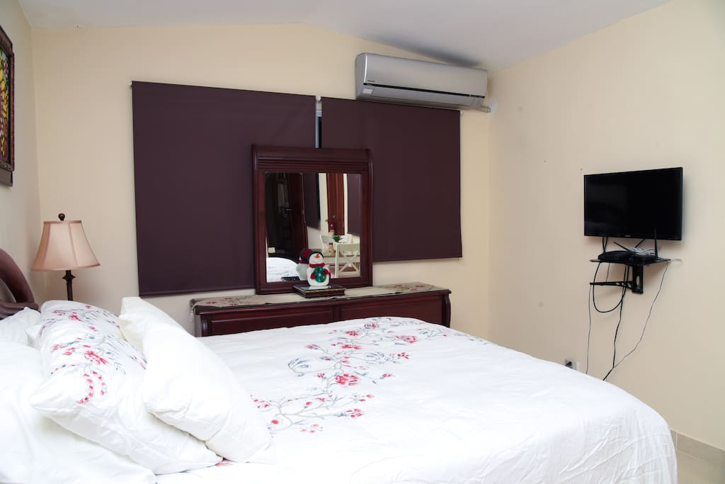 Bedroom view (dresser w/mirror, tv/cable, ac, blackout blinds and pillow top deluxe mattress for exceptional comfort)