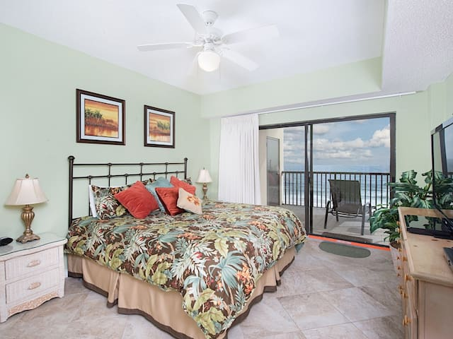 The master bedroom has a king bed and direct access to the Gulf-view balcony.