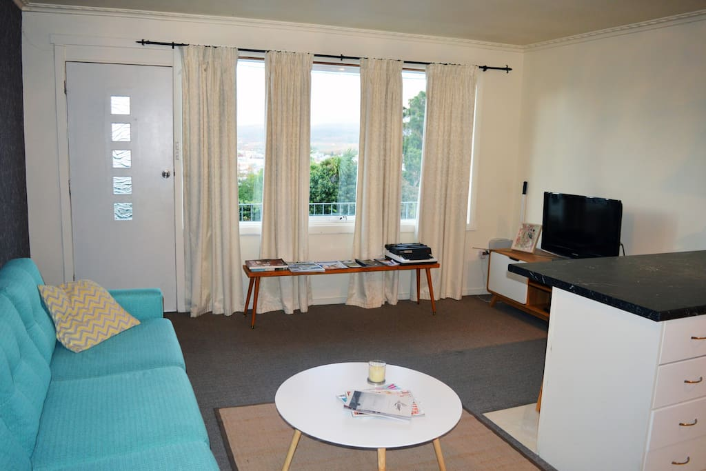 Cosy living area with beautiful views out the window of Launceston.