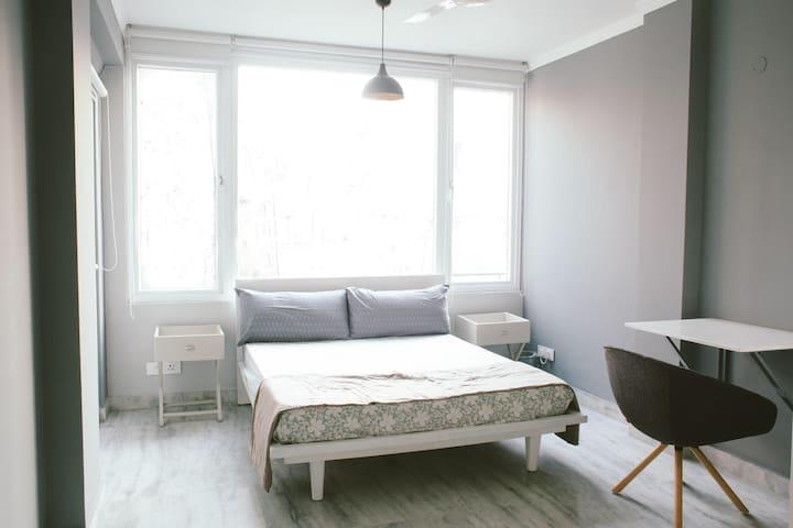 Bedroom 2(Ensuite)- Queen size bed, study desk & chair.