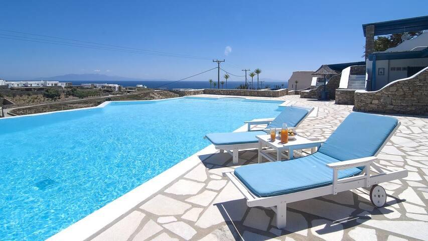 Elegant Villa with Panoramic Elia Beach Views